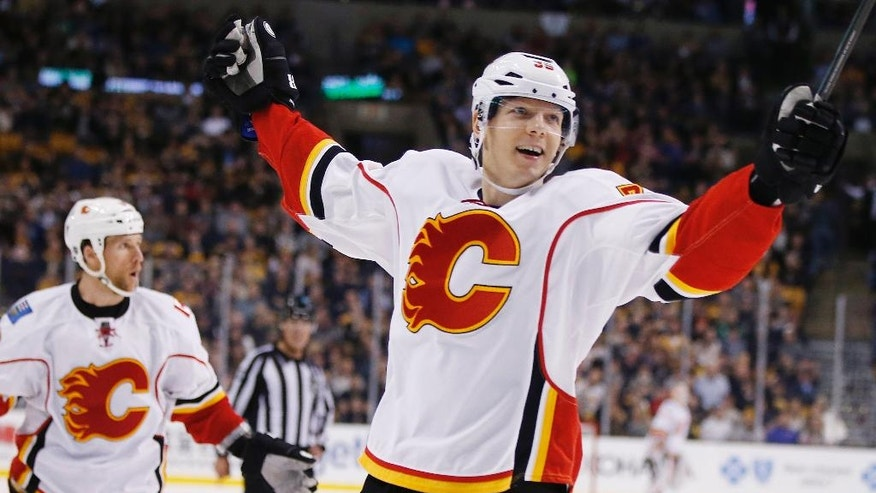 Calgary Flames' Alex Chiasson (39) celebrates his goal during the third period of an NHL hockey game against the Boston Bruins in Boston, Friday, Nov. 25, 2016. (AP Photo/Michael Dwyer)