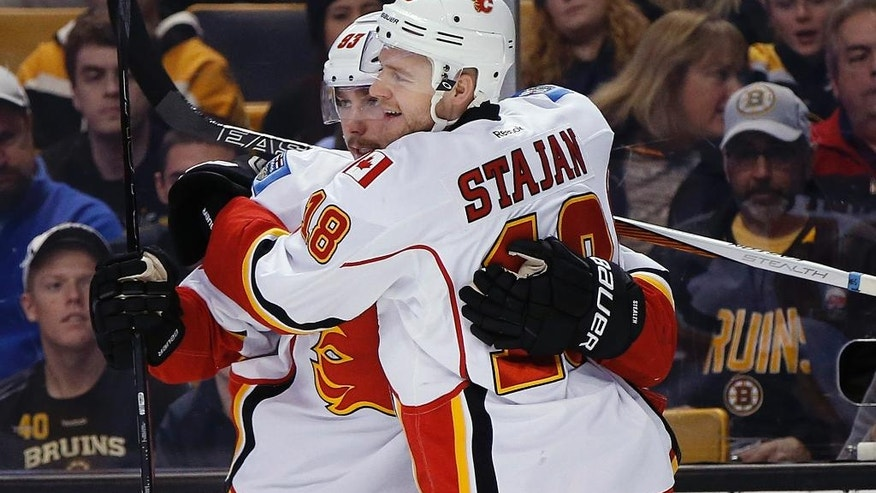Calgary Flames' Sam Bennett (93) celebrates his goal with teammate Matt Stajan (18) during the first period of an NHL hockey game against the Boston Bruins in Boston, Friday, Nov. 25, 2016. (AP Photo/Michael Dwyer)