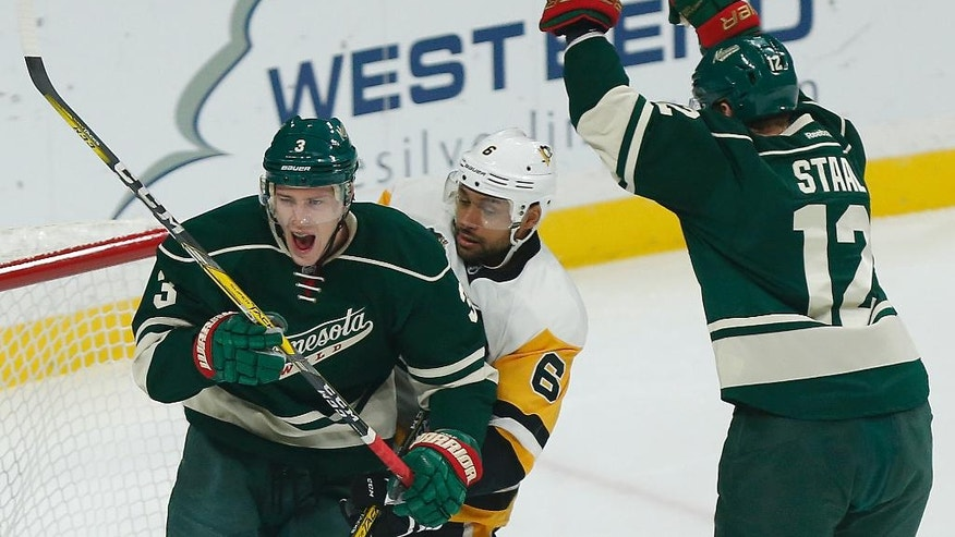Minnesota Wild's Charlie Coyle (3) reacts after scoring a goal against the Pittsburgh Penguins during the first period of an NHL hockey game Friday, Nov. 25, 2016, in St. Paul, Minn. (AP Photo/Stacy Bengs)