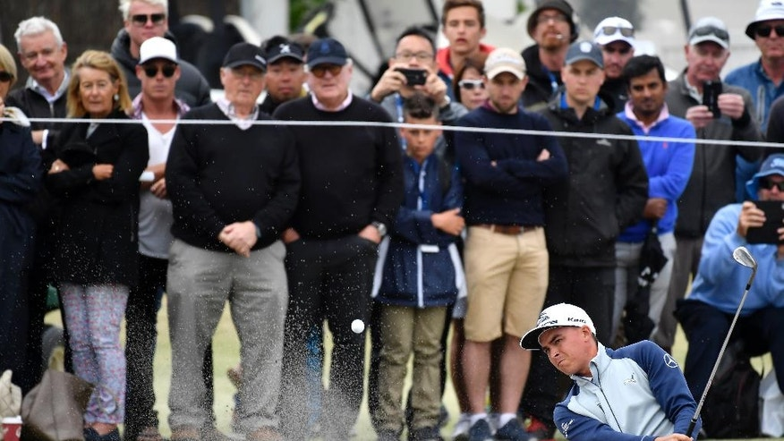 United States' Rickie Fowler plays from a bunker at the 18th green during his match at the World Cup of Golf at Kingston Heath in Melbourne, Australia, Friday, Nov. 25, 2016. (AP Photo/Andrew Brownbill)