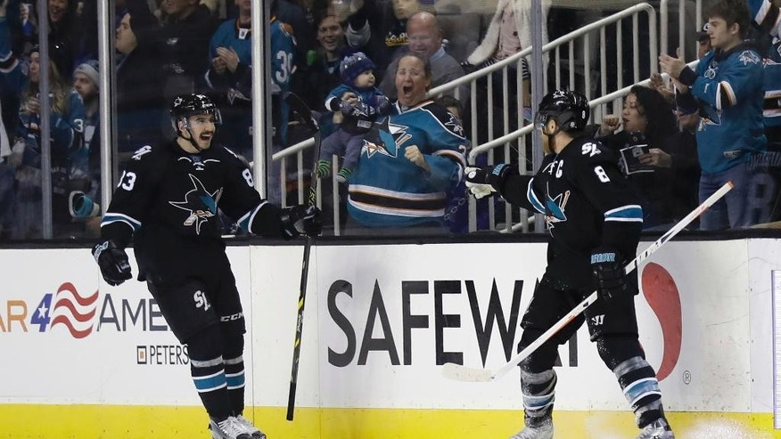 San Jose Sharks' Joe Pavelski, right, celebrates his goal with teammate Matt Nieto during the second period of an NHL hockey game against the New York Islanders, Friday, Nov. 25, 2016, in San Jose, Calif. (AP Photo/Marcio Jose Sanchez)