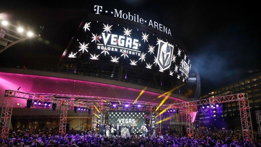 FILE - In this Tuesday, Nov. 22, 2016, file photo, the team name is displayed on a screen during an event to unveil the name of Las Vegas' National Hockey League franchise, in Las Vegas. The team will be called the Vegas Golden Knights. Preparations for the Vegas Golden Knights' expansion draft is well under way around the NHL. Vegas general manager George McPhee and his colleagues are in the process of putting together mock-ups and getting ready for June, the league's first expansion draft since 2000. (AP Photo/John Locher, File)
