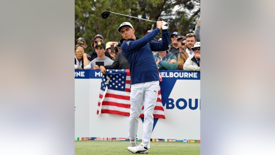 United States' Rickie Fowler watches his tee shot on the 12ht hole during his match at the World Cup of golf at Kingston Heath in Melbourne, Australia, Saturday, Nov. 26, 2016. (AP Photo/Andrew Brownbill)