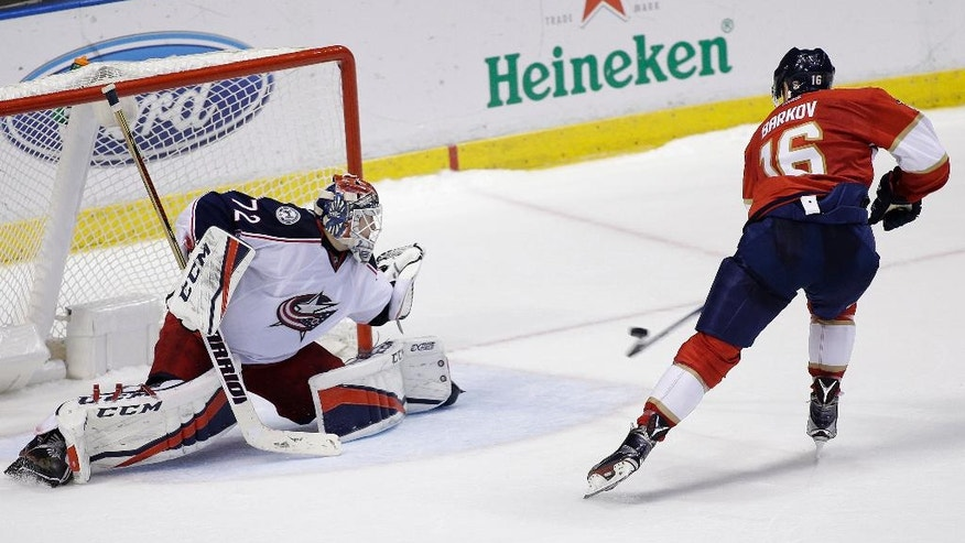 Florida Panthers center Aleksander Barkov (16) scores against Columbus Blue Jackets goalie Sergei Bobrovsky (72) during the shootout of an NHL hockey game, Saturday, Nov. 26, 2016, in Sunrise, Fla. (AP Photo/Terry Renna)