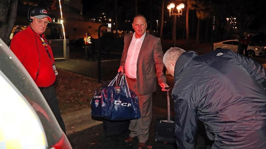 Gerard Gallant, center, former Florida Panthers head coach, approaches a cab after being relieved of his duties following an NHL hockey game against the Carolina Hurricanes, Sunday, Nov. 27, 2016, in Raleigh, N.C. (AP Photo/Karl B DeBlaker)