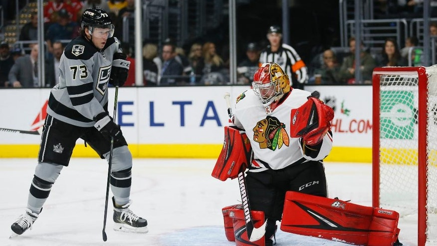 A goal by Los Angeles Kings defenseman Alec Martinez, not pictured, gets past Chicago Blackhawks goalie Scott Darling, right, while Kings center Tyler Toffoli, left, watches during the second period of an NHL hockey game, Saturday, Nov. 26, 2016, in Los Angeles. (AP Photo/Danny Moloshok)