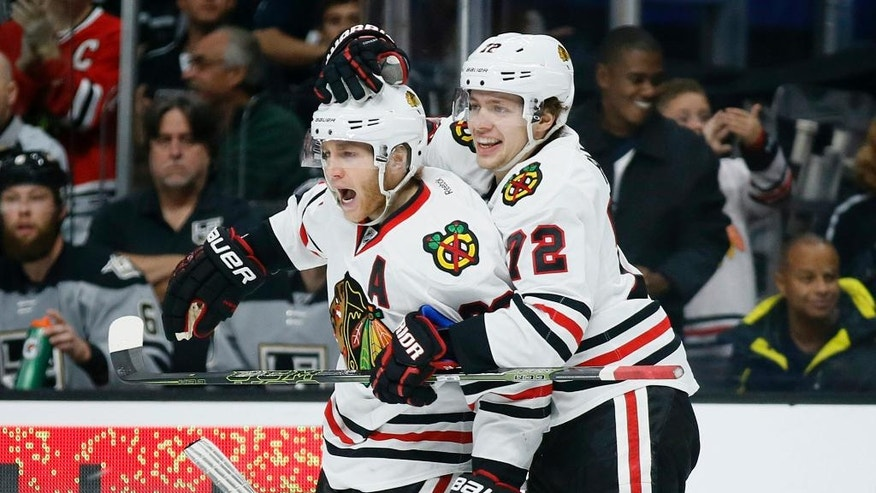 Chicago Blackhawks right wing Patrick Kane, left, celebrates scoring a goal with teammate Artemi Panarin, right, against the Los Angeles Kings during the first period of an NHL hockey game Saturday, Nov. 26, 2016, in Los Angeles. (AP Photo/Danny Moloshok)