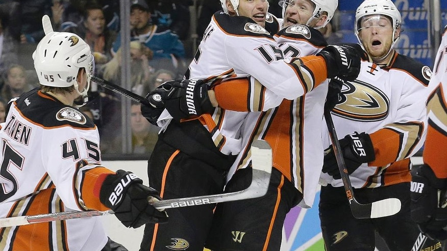 Anaheim Ducks center Ryan Getzlaf, center left, celebrates with teammates after scoring a goal against the San Jose Sharks during the second period of an NHL hockey game in San Jose, Calif., Saturday, Nov. 26, 2016. (AP Photo/Jeff Chiu)