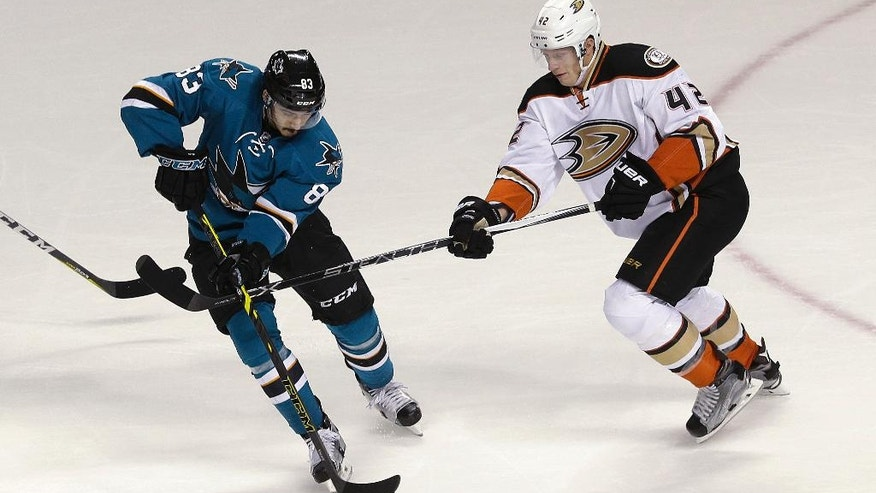 San Jose Sharks left wing Matt Nieto (83) reaches for the puck next to Anaheim Ducks defenseman Josh Manson (42) during the first period of an NHL hockey game in San Jose, Calif., Saturday, Nov. 26, 2016. (AP Photo/Jeff Chiu)