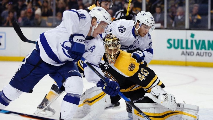 Tampa Bay Lightning's Ondrej Palat (18), of the Czech Republic, tries to get a shot off on Boston Bruins' Tuukka Rask (40), of Finland, during the first period of an NHL hockey game in Boston, Sunday, Nov. 27, 2016. (AP Photo/Michael Dwyer)