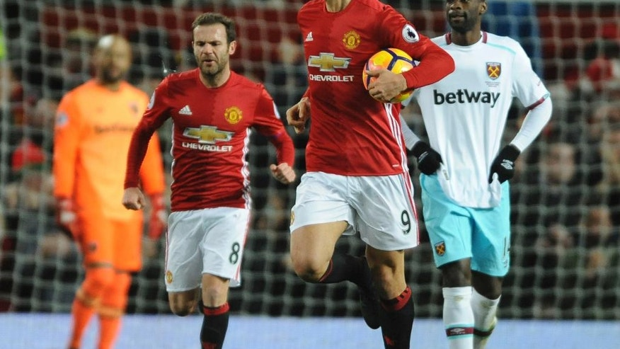 Manchester United's Zlatan Ibrahimovic holds ball after scoring during the English Premier League soccer match between Manchester United and West Ham United at Old Trafford in Manchester, England, Sunday, Nov. 27, 2016. (AP Photo/Rui Vieira)