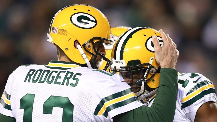 PHILADELPHIA, PA - NOVEMBER 28: Aaron Rodgers #12 and Davante Adams #17 of the Green Bay Packers celebrate after a touchdown in the first quarter against the Philadelphia Eagles at Lincoln Financial Field on November 28, 2016 in Philadelphia, Pennsylvania. (Photo by Elsa/Getty Images)