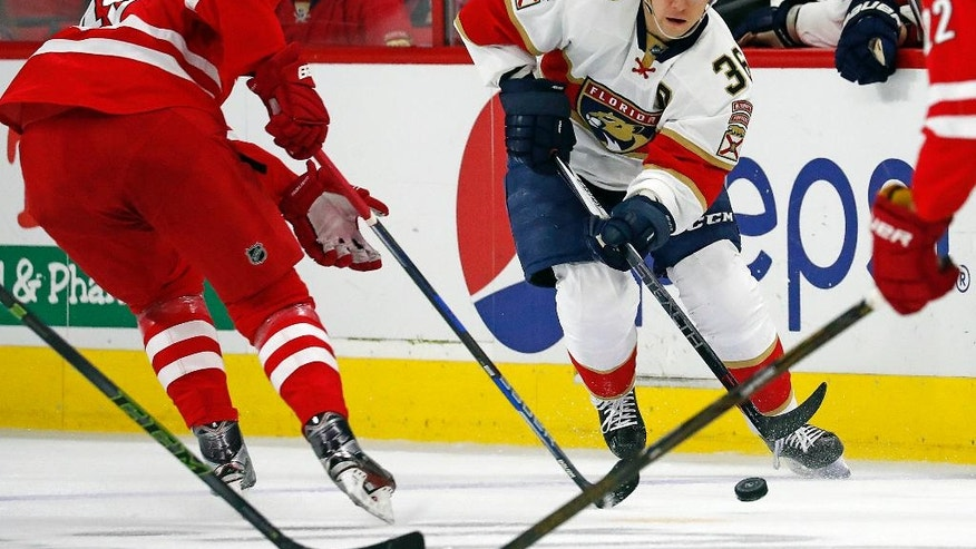Florida Panthers' Jussi Jokinen (36) passes the puck as Carolina Hurricanes' Victor Rask (49) closes in during the first period of an NHL hockey game, Sunday, Nov. 27, 2016, in Raleigh, N.C. (AP Photo/Karl B DeBlaker)