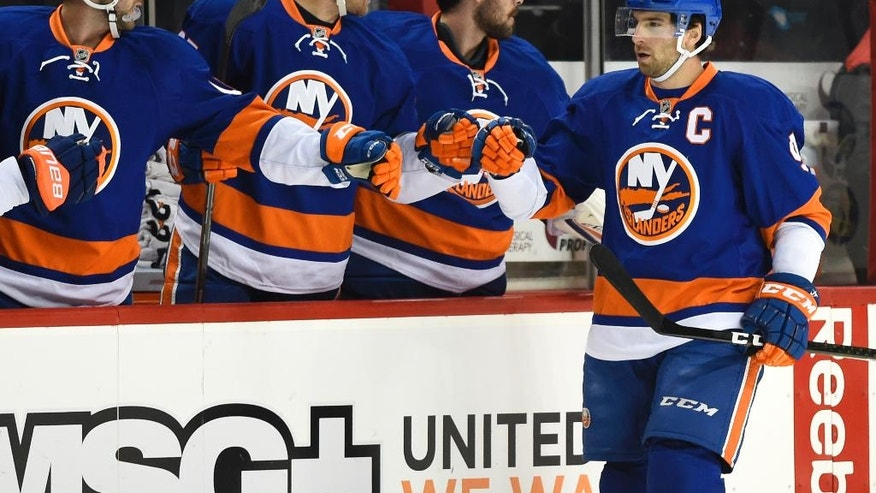 New York Islanders center John Tavares (91) celebrates his goal against the Calgary Flames with teammates in the first period of an NHL hockey game in New York, Monday, Nov. 28, 2016. (AP Photo/Kathy Kmonicek)