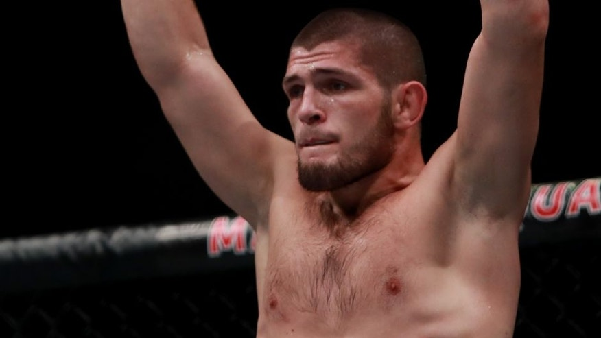 NEW YORK, NY - NOVEMBER 12: Khabib Nurmagomedov of Russia reacts against Michael Johnson of the United States in their lightweight bout during the UFC 205 event at Madison Square Garden on November 12, 2016 in New York City. (Photo by Michael Reaves/Getty Images )