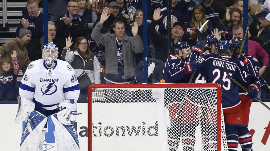 Columbus Blue Jackets players celebrat their goal against Tampa Bay Lightning's Andrei Vasilevskiy, of Russia, during the third period of an NHL hockey game Tuesday, Nov. 29, 2016, in Columbus, Ohio. The Blue Jackets defeated the Lightning 5-1. (AP Photo/Jay LaPrete)