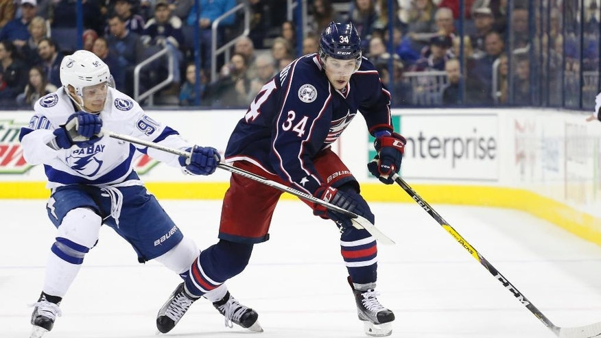 Columbus Blue Jackets' Josh Anderson, right, carries the puck up ice as Tampa Bay Lightning's Vladislav Namestnikov, of Russia, defends during the second period of an NHL hockey game, Tuesday, Nov. 29, 2016, in Columbus, Ohio. (AP Photo/Jay LaPrete)