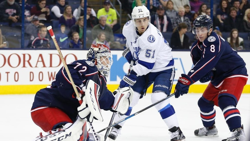 Columbus Blue Jackets' Sergei Bobrovsky, left, of Russia, makes a save as teammate Zach Werenski, right, and Tampa Bay Lightning's Valtteri Filppula, of Finland, look for the rebound during the first period of an NHL hockey game, Tuesday, Nov. 29, 2016, in Columbus, Ohio. (AP Photo/Jay LaPrete)