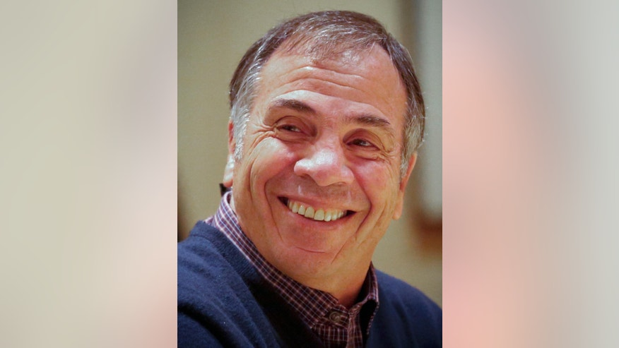 Bruce Arena, back in charge of the U.S. national soccer team for the first time in a decade, smiles during an interview in New York, Tuesday, Nov. 29, 2016. Arena was hired last week to replace Jurgen Klinsmann as U.S. coach following losses at home to Mexico and at Costa Rica in the first two games in the final round of World Cup qualifying. (AP Photo/Bebeto Matthews)