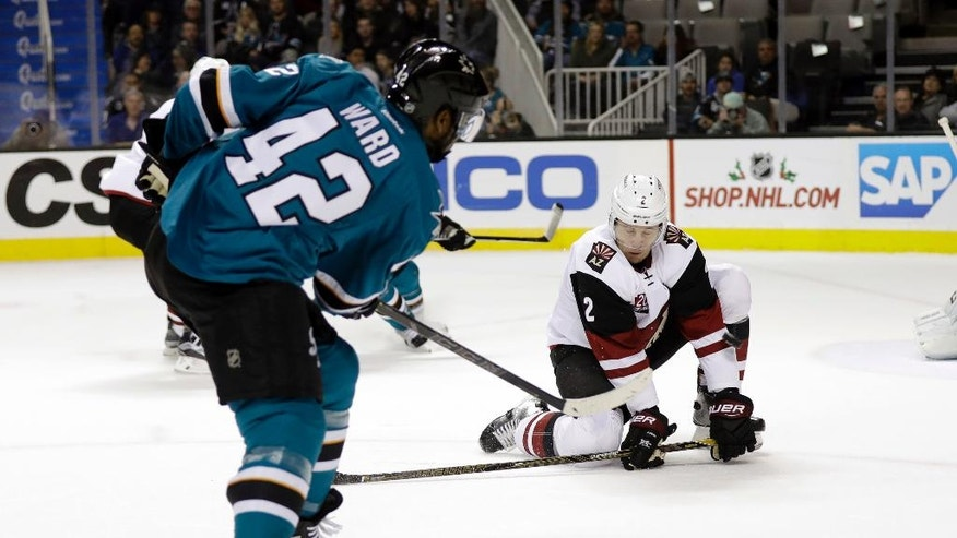 Arizona Coyotes' Luke Schenn (2) stops a shot from San Jose Sharks' Joel Ward (42) during the first period of an NHL hockey game, Tuesday, Nov. 29, 2016, in San Jose, Calif. (AP Photo/Marcio Jose Sanchez)