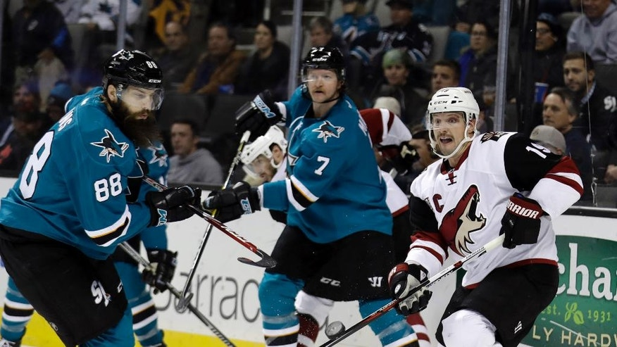 San Jose Sharks' Brent Burns (88) and Arizona Coyotes' Shane Doan, right, vie for the puck during the second period of an NHL hockey game, Tuesday, Nov. 29, 2016, in San Jose, Calif. (AP Photo/Marcio Jose Sanchez)