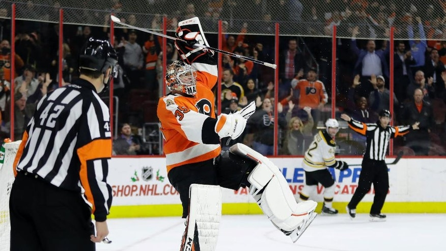 Philadelphia Flyers' Steve Mason (35) celebrates after blocking a shot by Boston Bruins' David Backes (42) during a shootout in an NHL hockey game, Tuesday, Nov. 29, 2016, in Philadelphia. Philadelphia won 3-2. (AP Photo/Matt Slocum)