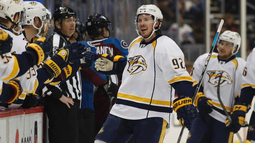 Nashville Predators center Ryan Johansen is congratulated by teammates as he passes the team box after scoring a goal against the Colorado Avalanche in the third period of an NHL hockey game, Tuesday, Nov. 29, 2016, in Denver. Nashville won 5-3. (AP Photo/David Zalubowski)