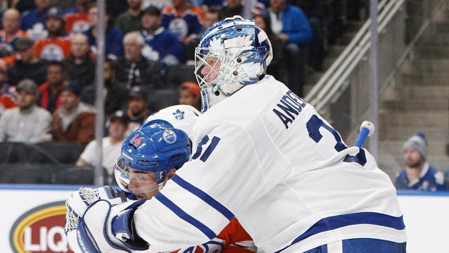 Toronto Maple Leafs' Frederik Andersen (31) holds to Edmonton Oilers' Jordan Eberle (14) during second period NHL hockey action in Edmonton, Alberta, Tuesday Nov. 29, 2016. (Jason Franson/The Canadian Press via AP)