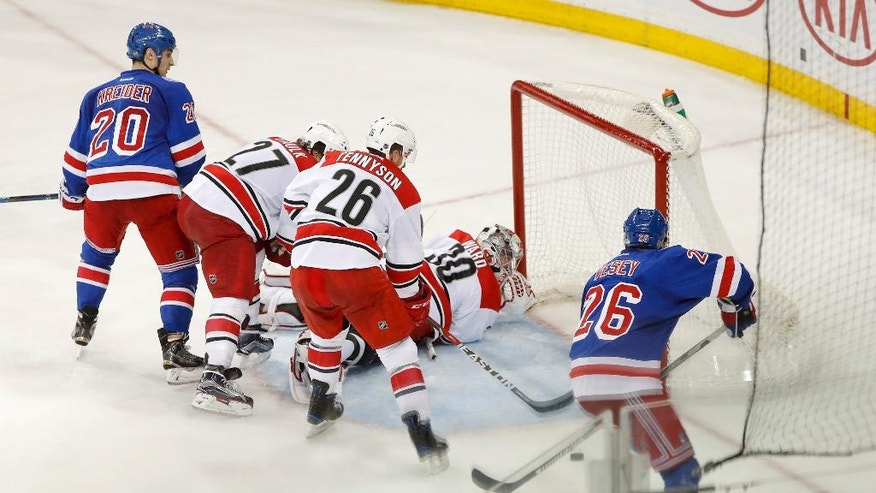 New York Rangers left wing Jimmy Vesey (26) knocks in a rebound for a goal against Carolina Hurricanes goalie Cam Ward (30) during the third period of an NHL hockey game, Tuesday, Nov. 29, 2016, in New York. The Rangers won 3-2. (AP Photo/Julie Jacobson)