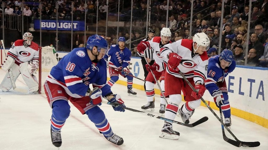 Carolina Hurricanes center Andrej Nestrasil (15) fights to control the puck against New York Rangers left wing J.T. Miller (10) and right wing Jesper Fast (19) during the second period of an NHL hockey game, Tuesday, Nov. 29, 2016, in New York. (AP Photo/Julie Jacobson)