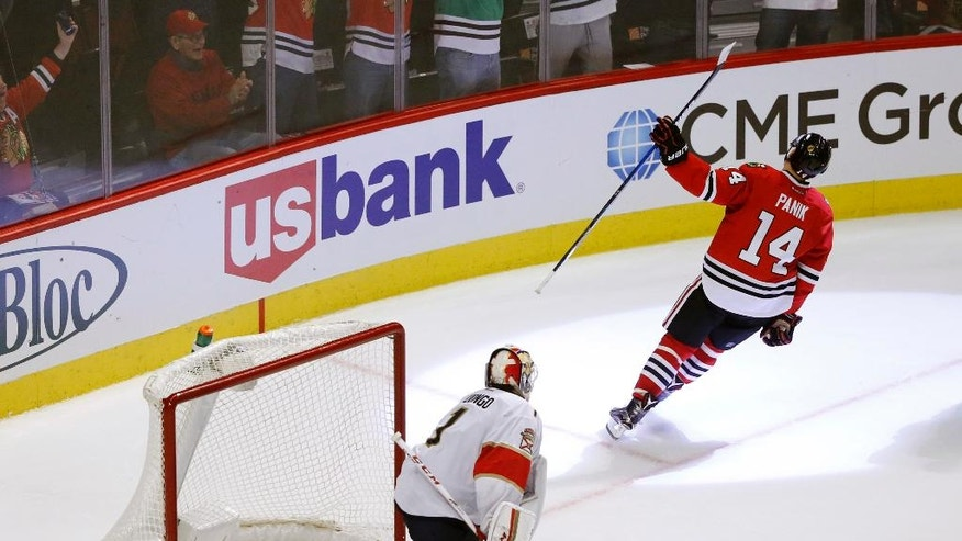 Chicago Blackhawks' Richard Panik (14) celebrate his goal against Florida Panthers' Roberto Luongo during the shootout of an NHL hockey game Tuesday, Nov. 29, 2016, in Chicago. (AP Photo/Charles Rex Arbogast)