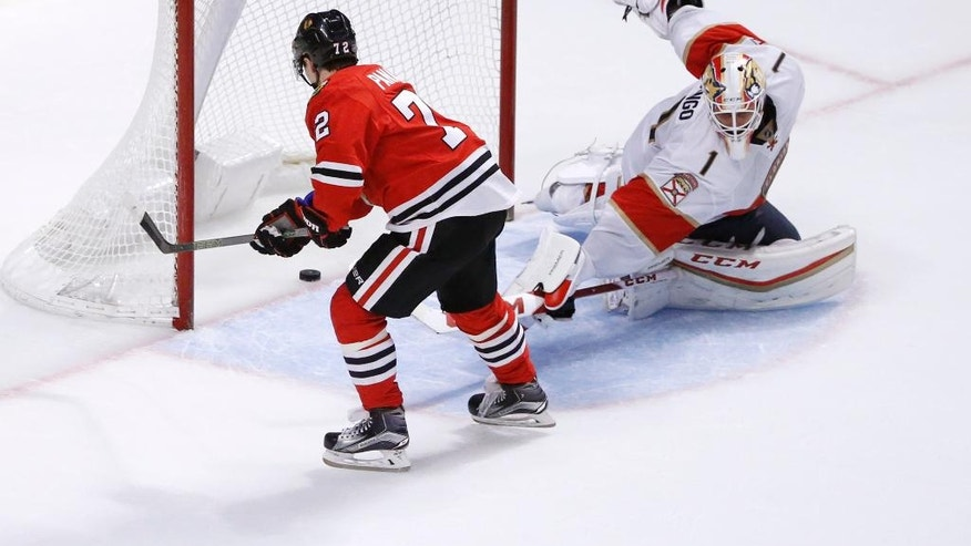 Chicago Blackhawks' Artemi Panarin (72) scores past Florida Panthers' Roberto Luongo during the shootout in an NHL hockey game Tuesday, Nov. 29, 2016, in Chicago. The Blackhawks won 2-1. (AP Photo/Charles Rex Arbogast)