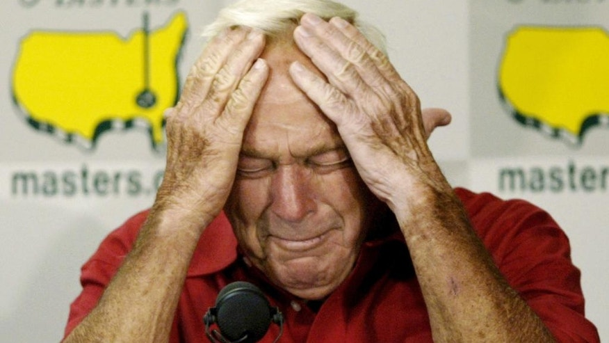 FILE - In this April 9, 2004, file photo, Arnold Palmer reacting during his press conference after playing his final round of Masters competition at the 2004 Masters golf tournament at the Augusta National Golf Club in Augusta, Ga. Tiger Woods turns 41 at the end of next month, and for the first time since he started this holiday tournament he is the oldest player in the field. Age is not the issue, though. It never is in golf. One of the greatest aspects of this sport is that it can be played a few years short of forever. At the elite level, however, that's also its greatest burden. Golf rarely offers a graceful exit. (AP Photo/Amy Sancetta, File)