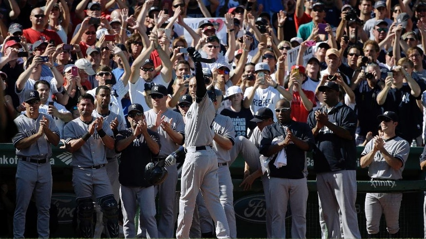 FILE - In this Sept. 28, 2014, file photo, New York Yankees designated hitter Derek Jeter, center, acknowledges cheers from the crowd as he leaves the game after an RBI hit in the third inning for the last at-bat of his career, in a baseball game against the Boston Red Sox at Fenway Park in Boston. Tiger Woods turns 41 at the end of next month, and for the first time since he started this holiday tournament he is the oldest player in the field. Age is not the issue, though. It never is in golf. One of the greatest aspects of this sport is that it can be played a few years short of forever. At the elite level, however, that's also its greatest burden. Golf rarely offers a graceful exit.  (AP Photo/Steven Senne, FIle)