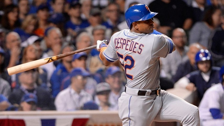 CHICAGO, IL - OCTOBER 20: Yoenis Cespedes #52 of the New York Mets singles in the top of the sixth inning of Game 3 of the NLCS against the Chicago Cubs at Wrigley Field on Tuesday, October 20, 2015 in Chicago , Illinois. (Photo by Ron Vesely/MLB Photos via Getty Images)