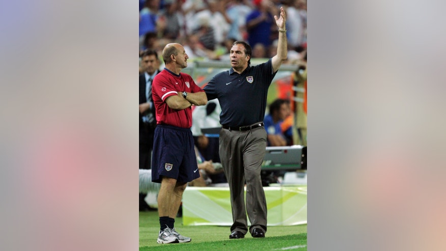 FILE - In this June 17, 2006, file photo, USA coach Bruce Arena, right, reacts after a USA goal was disallowed in the second half of their World Cup Group E soccer match against Italy in Kaiserslautern, Germany. Back in charge of the U.S. national soccer team for the first time in a decade, Bruce Arena views the Americans' state as urgent following losses in the first two games of the final round of World Cup qualifying.  (AP Photo/Kevork Djansezian, File)