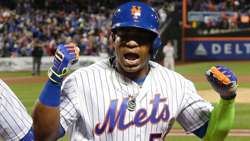 FILE - In this April 29, 2016, file photo, New York Mets' Yoenis Cespedes (52) reacts after hitting a grand slam home run against the San Francisco Giants during the third inning of a baseball game, in New York. A person familiar with the negotiations says outfielder Yoenis Cespedes and the New York Mets have agreed to a $110 million, four-year contract. The person spoke on condition of anonymity Tuesday, Nov. 29, 2016, because the agreement is subject to Cespedes successfully completing a physical. (AP Photo/Julie Jacobson, File)