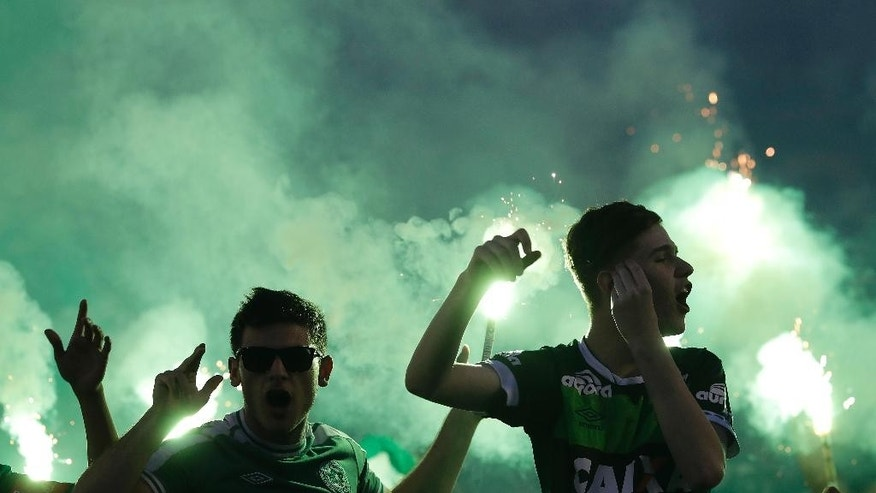 Supporters of the Chapecoense soccer team gather inside Arena Condado stadium in Chapeco, Brazil, Wednesday, Nov. 30, 2016, in tribute to members of their team who died in an airplane crash in Colombian on Monday night. (AP Photo/Andre Penner)