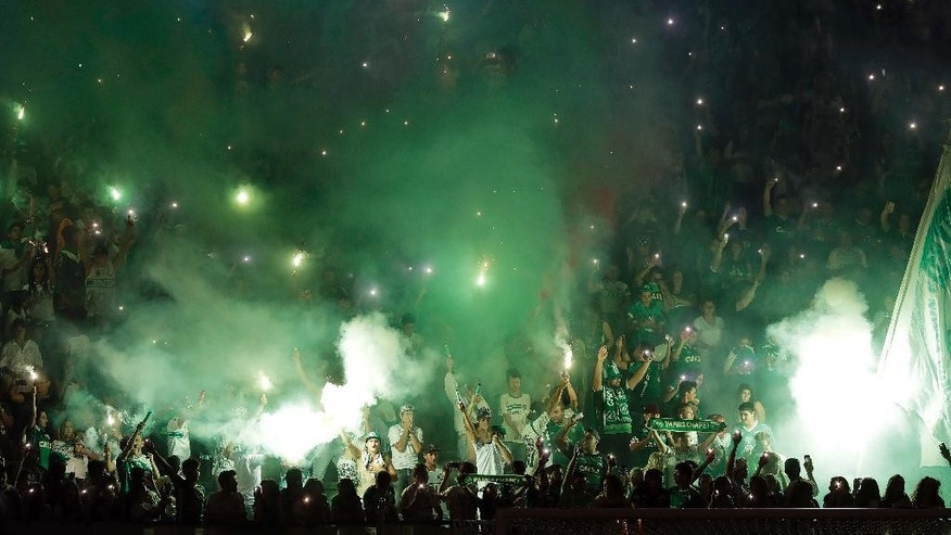 Supporters of the Chapecoense soccer team cheer inside Arena Condado stadium in Chapeco, Brazil, Wednesday, Nov. 30, 2016, in tribute to members of their team who died in an airplane crash in Colombian on Monday night. (AP Photo/Andre Penner)