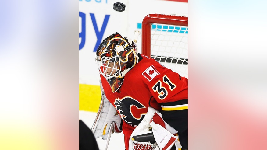 Calgary Flames goalie Chad Johnson stops a shot by the Toronto Maple Leafs during the first period of an NHL hockey game Wednesday, Nov. 30, 2016, in Calgary, Alberta. (Larry MacDougal/The Canadian Press via AP)