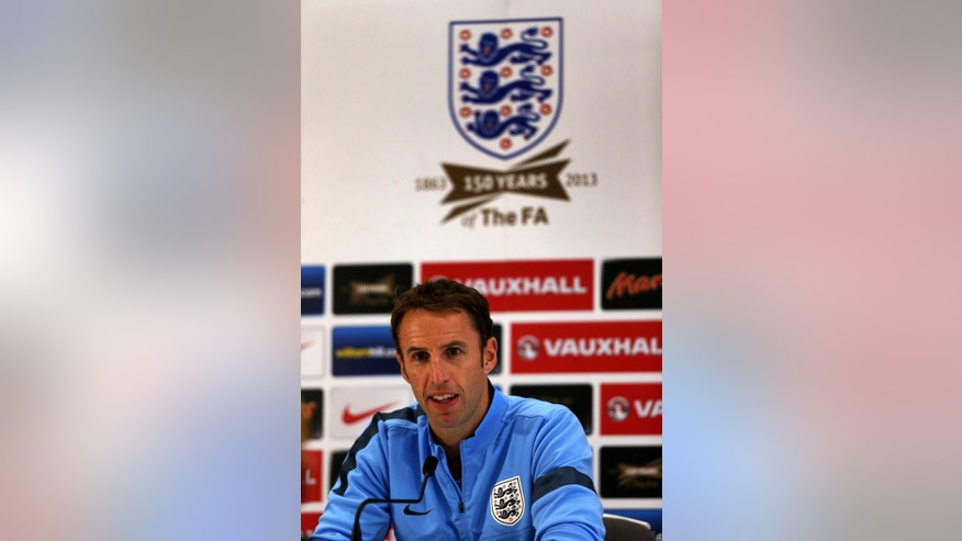FILE - In this Oct. 8, 2013 file photo, England's U21 Manager Gareth Southgate takes part in a press conference in Burton, England. The English Football Association has hired Gareth Southgate on a four-year contract to remain in charge of the national team, it was announced on Wednesday, Nov. 30, 2016. (Nick Potts/PA via AP, file)