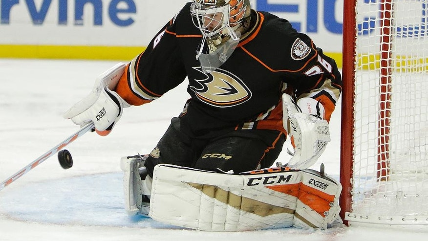 Anaheim Ducks goalie John Gibson makes a save during the first period of an NHL hockey game against the Montreal Canadiens Tuesday, Nov. 29, 2016, in Anaheim, Calif. (AP Photo/Jae C. Hong)