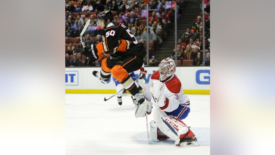 Anaheim Ducks' Antoine Vermette, left, jumps out of the way of the puck in front of Montreal Canadiens goalie Carey Price during the second period of an NHL hockey game Tuesday, Nov. 29, 2016, in Anaheim, Calif. (AP Photo/Jae C. Hong)