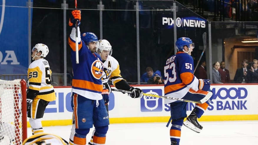 New York Islanders' center Casey Cizikas (53) and Islanders' right wing Cal Clutterbuck (15) celebrate after Cizikas scored a goal on Pittsburgh Penguins goalie Matt Murray (30) lower right, during the second period of an NHL hockey game, Wednesday, Nov. 30, 2016, in New York. (AP Photo/Kathy Willens)