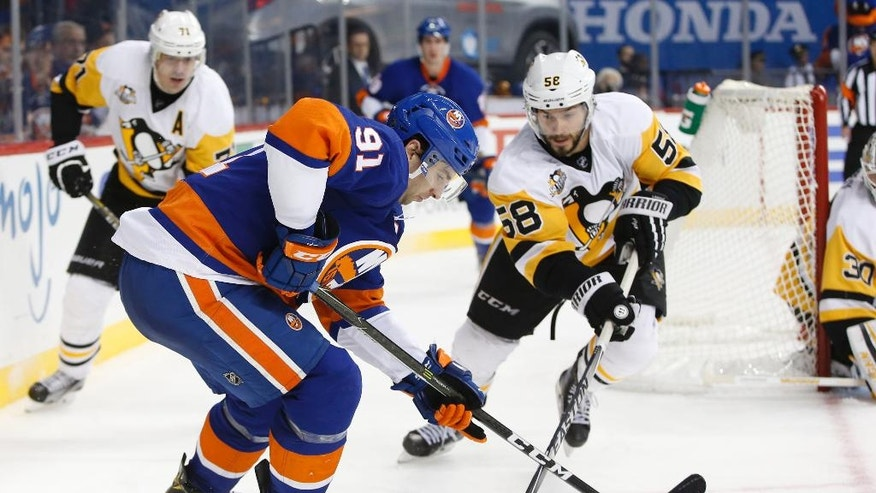 Pittsburgh Penguins defenseman Kris Letang (58) challenges New York Islanders center John Tavares (91) during the second period of an NHL hockey game, Wednesday, Nov. 30, 2016, in New York. (AP Photo/Kathy Willens)