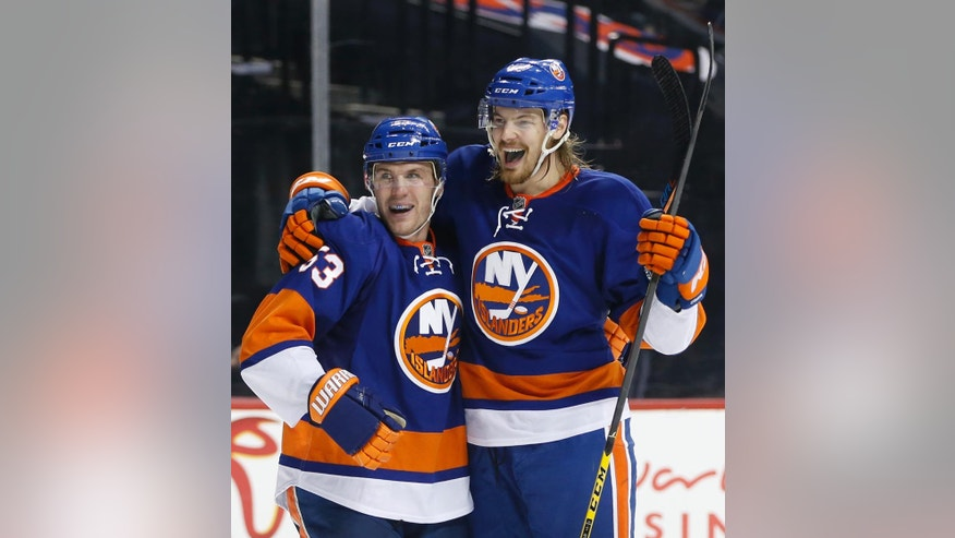 New York Islanders' center Casey Cizikas (53) and Islanders' defenseman Scott Mayfield celebrate after Cizikas scored a goal on Pittsburgh Penguins goalie Matt Murray during the second period of an NHL hockey game, Wednesday, Nov. 30, 2016, in New York. (AP Photo/Kathy Willens)