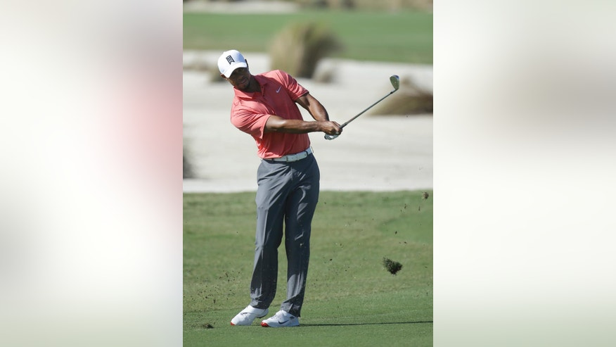 Tiger Woods hits from the sixth fairway during the Pro-Am at the Hero World Challenge golf tournament, Wednesday, Nov. 30, 2016, in Nassau, Bahamas. (AP Photo/Lynne Sladky)