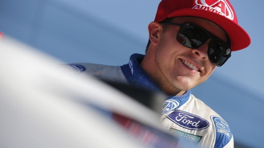 BROOKLYN, MI - AUGUST 26: Trevor Bayne, driver of the #6 AdvoCare Ford, smiles during qualifying for the NASCAR Sprint Cup Series Pure Michigan 400 at Michigan International Speedway on August 26, 2016 in Brooklyn, Michigan. (Photo by Brian Lawdermilk/NASCAR via Getty Images)