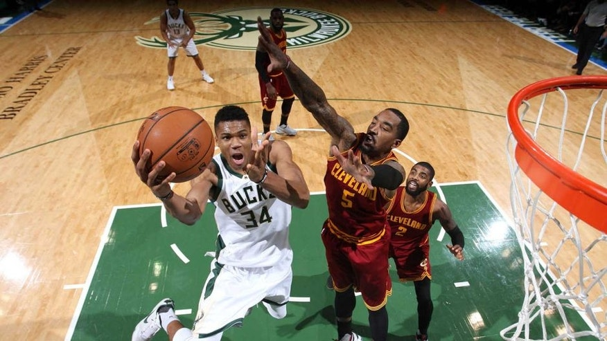 Milwaukee, WI - NOVEMBER 29: Giannis Antetokounmpo #34 of the Milwaukee Bucks shoots a lay up during the game against the Cleveland Cavaliers on November 29, 2016 at the BMO Harris Bradley Center in Milwaukee, Wisconsin. NOTE TO USER: User expressly acknowledges and agrees that, by downloading and or using this Photograph, user is consenting to the terms and conditions of the Getty Images License Agreement. Mandatory Copyright Notice: Copyright 2016 NBAE (Photo by Gary Dineen/NBAE via Getty Images)