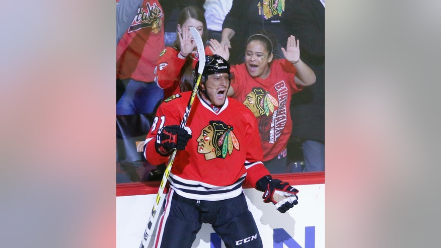 Chicago Blackhawks' Marian Hossa (81) celebrate his game winning goal during the overtime period of an NHL hockey game against the New Jersey Devils Thursday, Dec. 1, 2016, in Chicago. The Blackhawks won 4-3. (AP Photo/Charles Rex Arbogast)